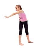 Ung flicka som gör gymnastisk övning för sträckning och för böjlighet Royaltyfria Foton