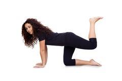 Ung flicka som gör Yoga, övar Royaltyfria Foton