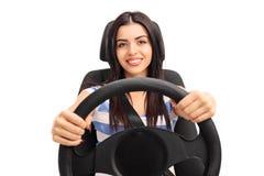Ung flicka som låtsar för att köra Royaltyfri Bild
