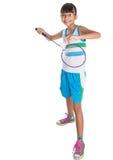 Ung flicka som spelar badminton III Fotografering för Bildbyråer
