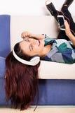 Ung flicka som tycker om medan lyssnande musik Fotografering för Bildbyråer
