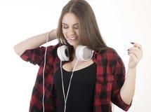 ung flickahörlurar Arkivfoton