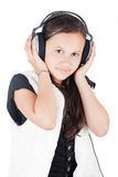 ung flickahörlurar Arkivfoto