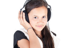 ung flickahörlurar Royaltyfri Fotografi