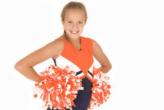 Ung flickahejaklacksledareanseende med pompoms Royaltyfria Foton