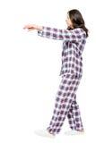 Ung flickalidande från sleepwalking i en dröm, stående Arkivbild