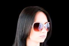 ung flickasolglasögon Arkivfoton