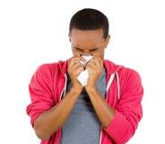 Ung grabb med en allergi eller en förkylning Fotografering för Bildbyråer
