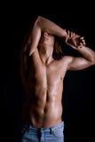 Ung grabb med långt hår som är naket Arkivfoto