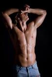 Ung grabb med långt hår som är naket Fotografering för Bildbyråer