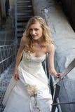 Ung härlig blond kvinna i brud- klänning Fotografering för Bildbyråer