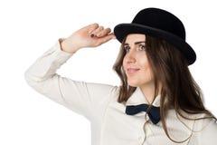 Ung härlig flicka i svart hatt Royaltyfri Fotografi