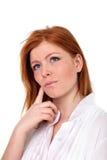 Ung härlig flicka som gör ett beslut Arkivfoto