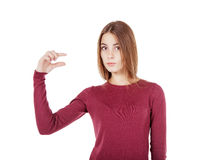 Ung härlig flicka som lite visar gest Royaltyfri Fotografi
