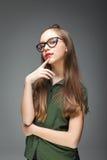 Ung härlig glasögonprydd flicka Royaltyfria Bilder