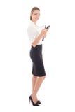 Ung härlig hållande mobiltelefon för affärskvinna som isoleras på wh Arkivfoton