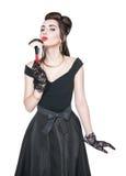 Ung härlig kvinna i övre stil för retro stift med makeupborsten Royaltyfria Foton