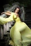 Ung härlig kvinna på trappan royaltyfria foton