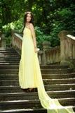 Ung härlig kvinna på trappan royaltyfria bilder