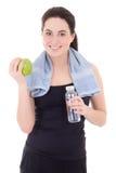 Ung härlig sportig kvinna med flaskan av mineralvatten och ap Arkivbild
