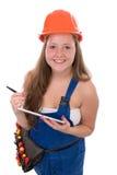 Ung hantverkerska med den isolerade toolbeltind-minnestavlan Fotografering för Bildbyråer