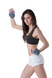 Ung idrotts- kvinna bärande vikter för en handled Arkivbilder