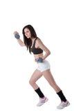 Ung idrotts- kvinna bärande vikter för en handled Arkivfoton