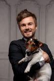 Ung kamrat med hans hund Royaltyfri Bild