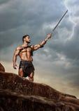 Ung krigare på ett bergmaximum Royaltyfria Bilder