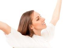 Ung kvinna, hennes framsida uppåt som tycker om solen Arkivbilder