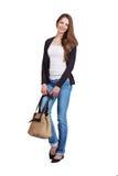 Ung kvinna i jeans och pullover Royaltyfria Bilder