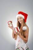 Ung kvinna i Santa Claus Royaltyfria Foton