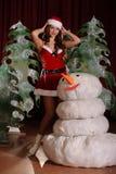 Ung kvinna i snowgirlklänning Fotografering för Bildbyråer