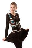 Ung kvinna i stilfull klänning Arkivfoto