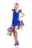 Ung kvinna - jul som shoppar begrepp Arkivbild
