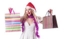 Ung kvinna - jul som shoppar begrepp Arkivfoto