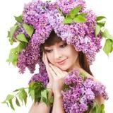 Ung kvinna med blommor Royaltyfri Foto