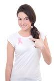 Ung kvinna med det rosa cancerbandet på bröstet Fotografering för Bildbyråer