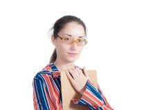Ung kvinna med en mapp Arkivfoto