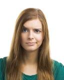 Ung kvinna med en misstänksam framsida fotografering för bildbyråer