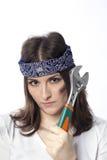 Ung kvinna med ett hjälpmedel Fotografering för Bildbyråer