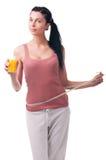 Ung kvinna med fruktsaft Arkivfoton