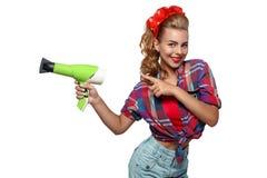 Ung kvinna med hårtork Royaltyfri Foto