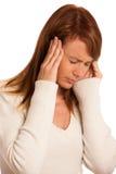 Ung kvinna med huvudvärk royaltyfria foton