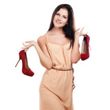 Ung kvinna med röda skor Royaltyfria Bilder