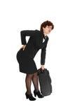 Ung kvinna med resväska arkivfoto