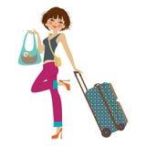 Ung kvinna med resväskan Royaltyfria Bilder