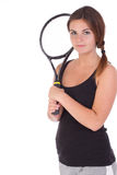 Ung kvinna med tennisracket fotografering för bildbyråer