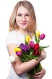 Ung kvinna med tulpan royaltyfri bild