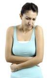 Ung kvinna med tummyache Arkivfoton